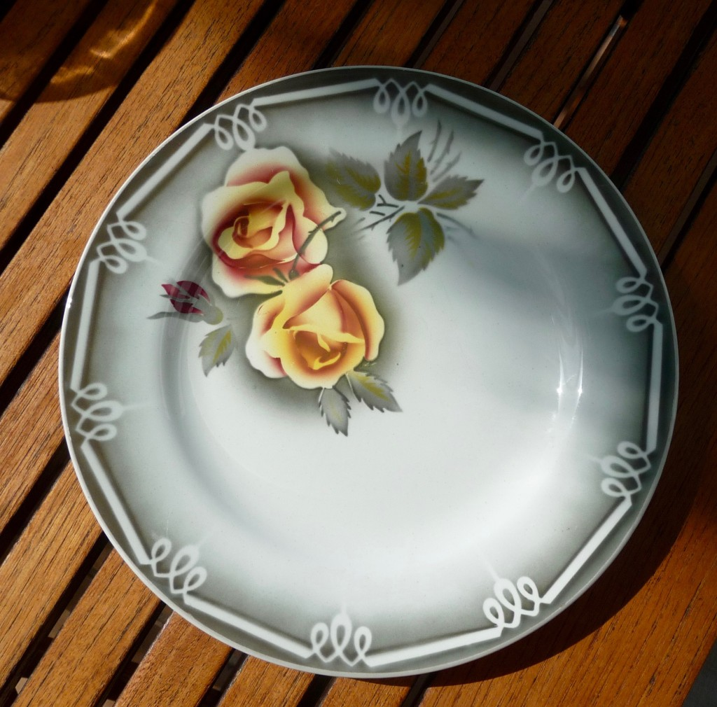 One of the stylish ingredients of the kitchen. Old French dishes from the famous Digoin factory.